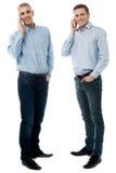 两个年轻人谈话通过手机 免版税库存图片
