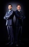 两个年轻商人充分的身体 免版税库存图片