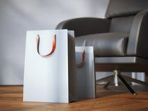 两个购物袋临近现代黑扶手椅子 3d翻译 库存图片