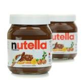 两个玻璃瓶子Nutella巧克力传播 图库摄影