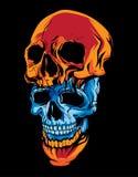两件蓝色和橙色头骨头在黑暗的背景中 免版税库存图片