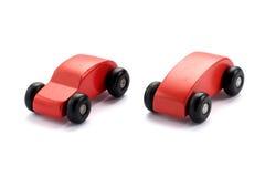 两传统化了孩子的木玩具汽车 免版税库存图片
