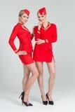 两位愉快的空中小姐 免版税库存照片
