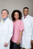 两位牙医和一位牙齿护士 免版税库存图片