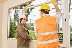 两位窗口钳工装配窗口 免版税库存图片