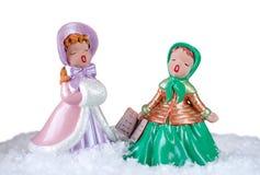 两位美丽的葡萄酒颂歌歌手的圣诞节图象 库存图片