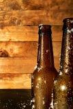 两冷淡的啤酒瓶新近地被采取在冰箱外面 免版税库存图片