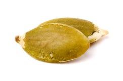 两剥了宏观绿色的南瓜籽 免版税图库摄影
