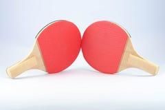 两副红色乒乓球球拍 图库摄影