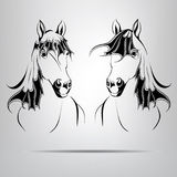 两匹马剪影。传染媒介例证 免版税库存照片