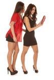 两名妇女装饰了神色在片剂 免版税图库摄影
