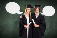 两名学生的综合图象毕业生长袍的并肩 免版税库存图片
