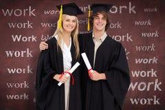 两名学生的综合图象毕业生长袍的并肩 免版税库存照片
