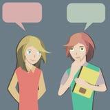 两名学生聊天 库存照片