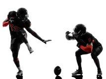 两名美国橄榄球运动员触地得分庆祝剪影 图库摄影