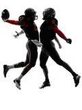 两名美国橄榄球运动员触地得分庆祝剪影 库存照片