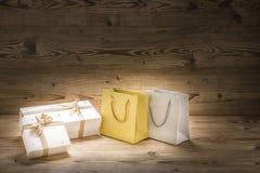 两圣诞礼物和两购物带来 图库摄影
