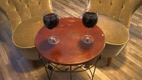 两在一张桌上的葡萄酒杯除两把古色古香的椅子以外 图库摄影