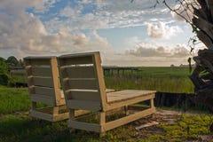两在日落的椅子 免版税库存照片