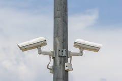 两在柱子的CCTV 免版税库存照片