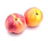 两在白色背景的成熟桃子 免版税图库摄影
