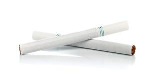 两在白色背景的香烟 免版税库存照片