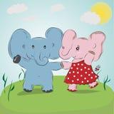 两在草甸的逗人喜爱的大象男孩和女孩跳舞 免版税库存照片