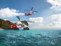 两在蓝天的红色抢救直升机飞行 库存照片