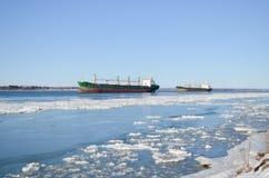 两在被冰的河的小船 免版税图库摄影