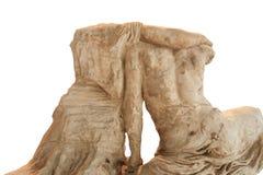 两坐的人雕塑的一个帮助的手古老破旧和残破的片段从后面观看的没有头-一与 库存照片