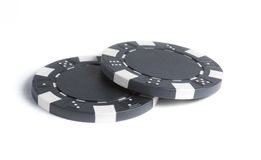 两块孤立黑赌博芯片 免版税库存照片