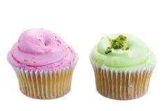 两块杯形蛋糕桃红色和绿色 库存照片