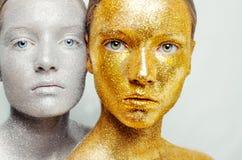 两妇女美丽,惊人的画象  库存照片