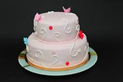 两层蝴蝶方旦糖蛋糕 库存图片