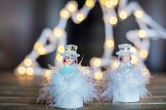 两带领了圣诞节装饰的雪花 免版税图库摄影