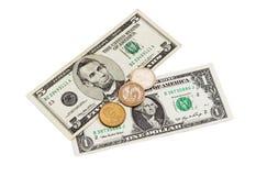 两张钞票和美国美元三枚硬币  免版税库存照片