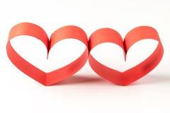 两心脏由丝带制成在白色背景 免版税库存图片