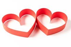 两心脏由丝带制成在白色背景 库存图片