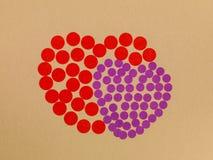 以两心脏的形式色的斑点 库存照片