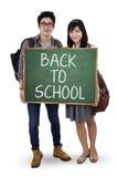 两拿着小黑板的学生 库存图片