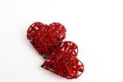 两时髦的红色心脏,隔绝在白色背景,华伦泰 图库摄影