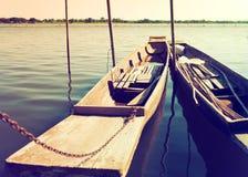 两条老木小船紧密靠码头 库存图片