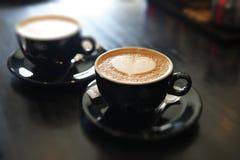 两杯咖啡热奶咖啡 免版税图库摄影