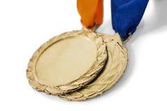 两枚奥运金牌奖牌 免版税库存图片