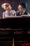两架钢琴音乐家钢琴音乐使用,妇女和人 免版税图库摄影