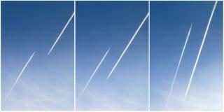 两架飞机踪影在天空的 库存图片