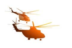 两架直升机在太阳旁边飞行 库存图片