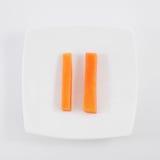 两棵新鲜的橙色红萝卜 免版税库存照片