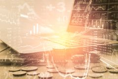 两次曝光在财政统计数据的企业辅助部件 图库摄影