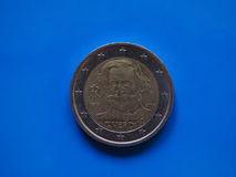 两欧元硬币,在蓝色的欧盟 免版税库存图片
